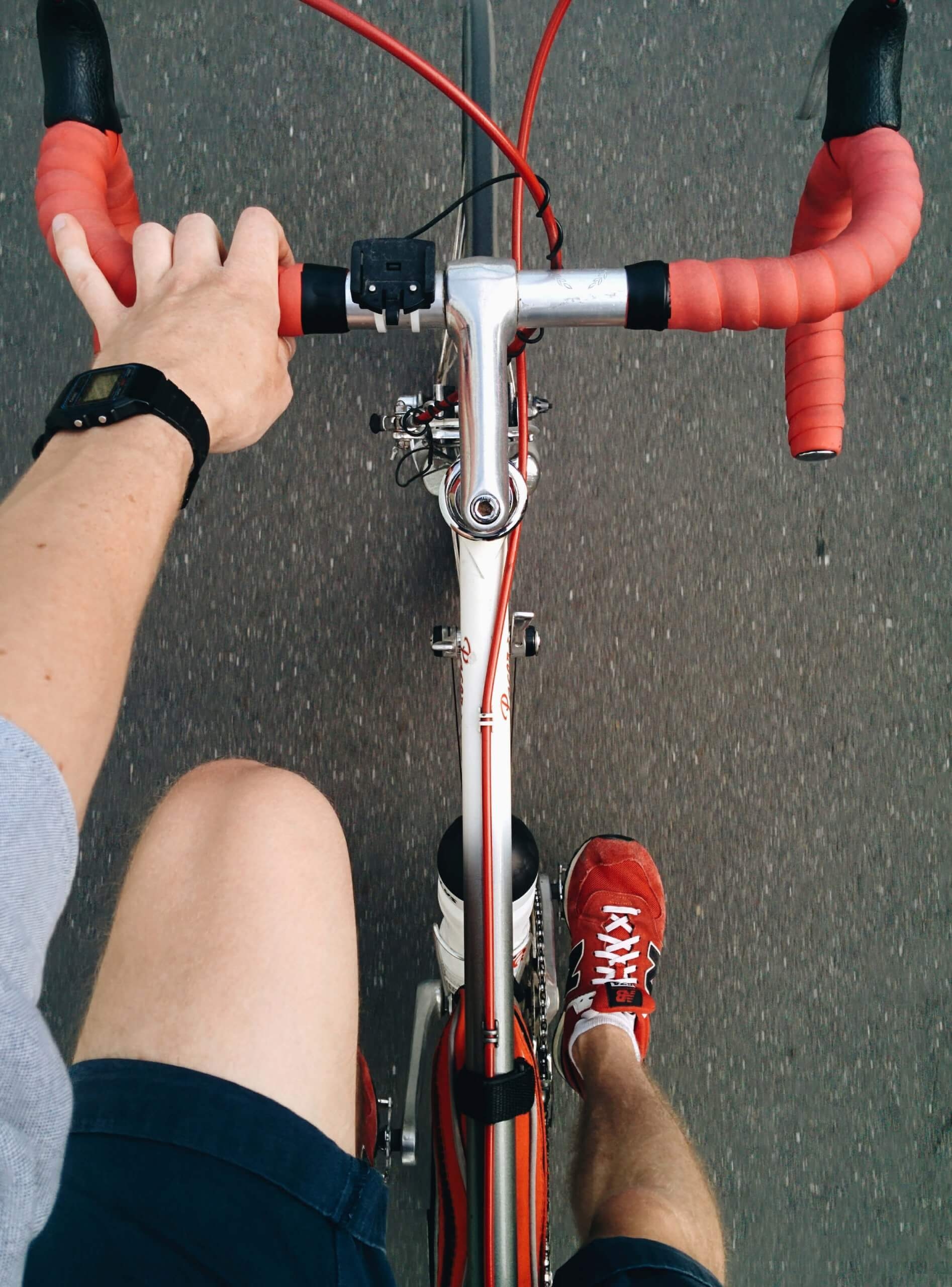 Canva-Man-Riding-on-Silver-and-Red-Road-Bike.jpg